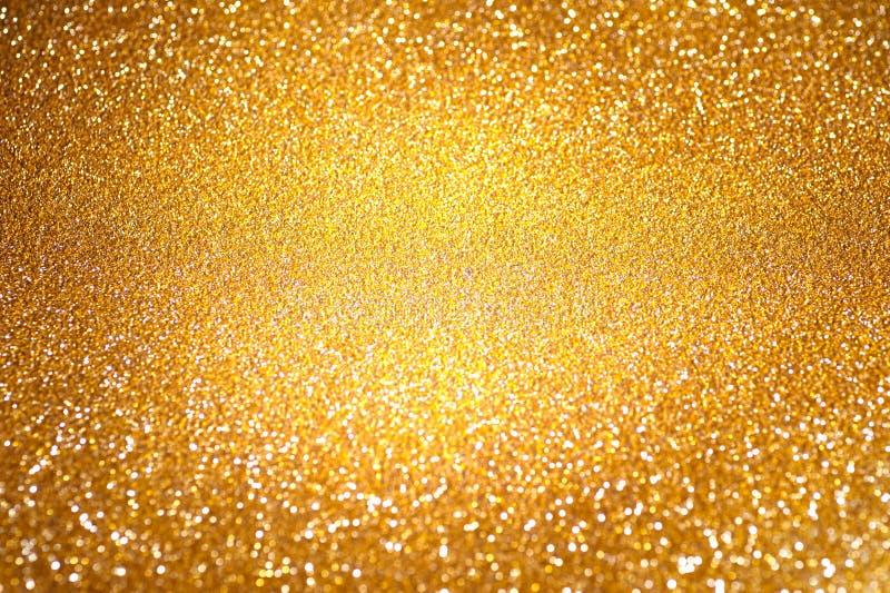 Fondo defocused abstracto de oro imagenes de archivo