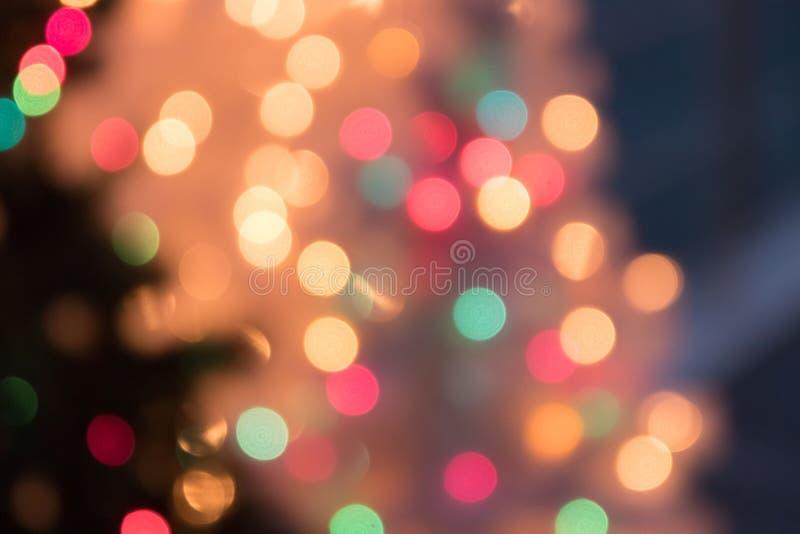 Fondo Defocused de la luz del bokeh por la Navidad y el Año Nuevo Cele fotografía de archivo