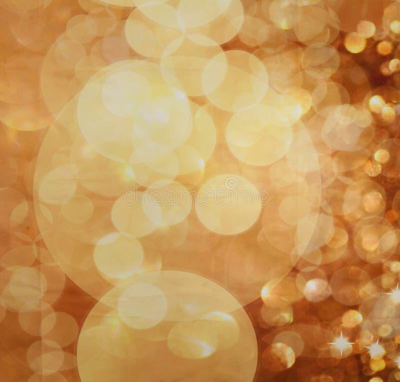 Fondo defocused di festa di scintillio dorato dell'estratto fotografia stock