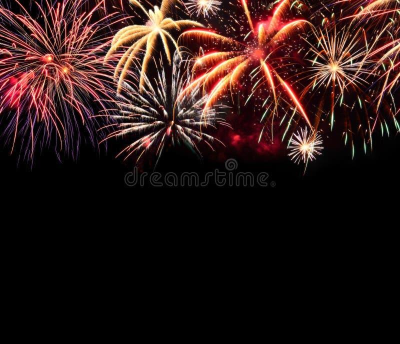 Fondo dei fuochi d'artificio isolato sul nero fotografia stock