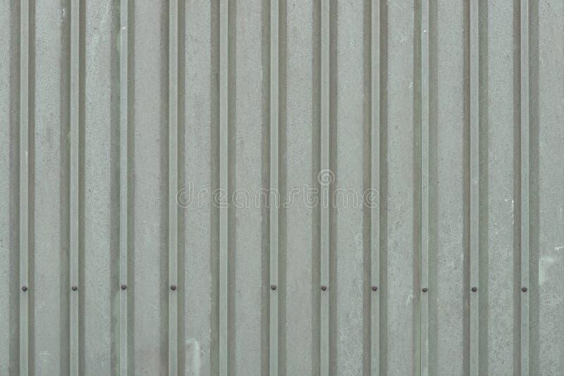 Fondo dei pannelli di parete verde scuro stagionati del metallo fotografia stock libera da diritti