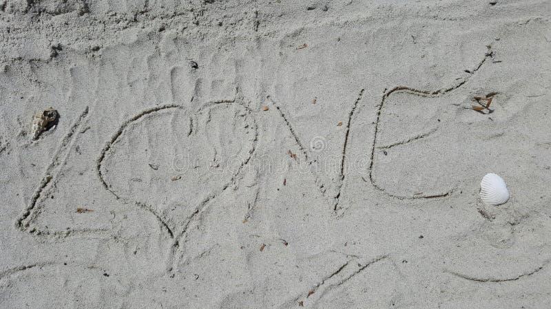 Fondo del amor de la arena imágenes de archivo libres de regalías
