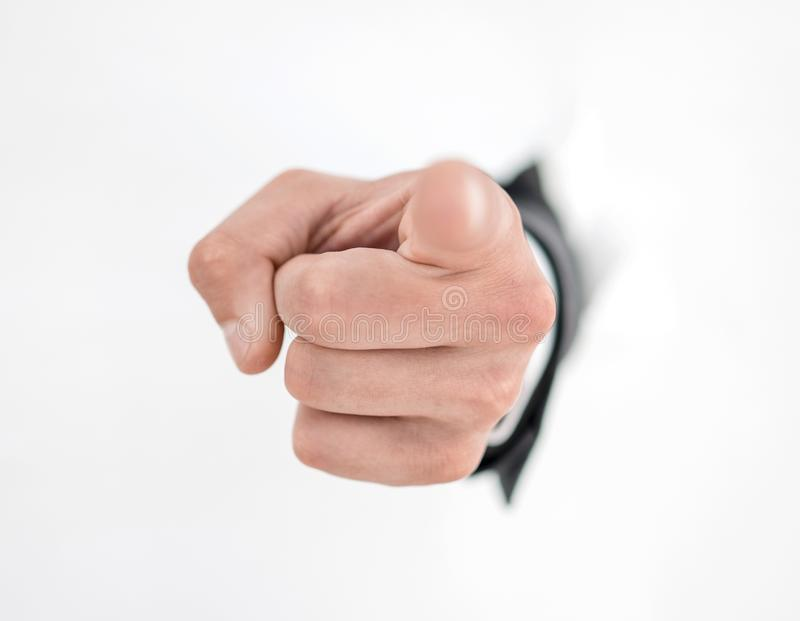 Fondo del asunto la mano de un hombre que señala en usted imagen de archivo