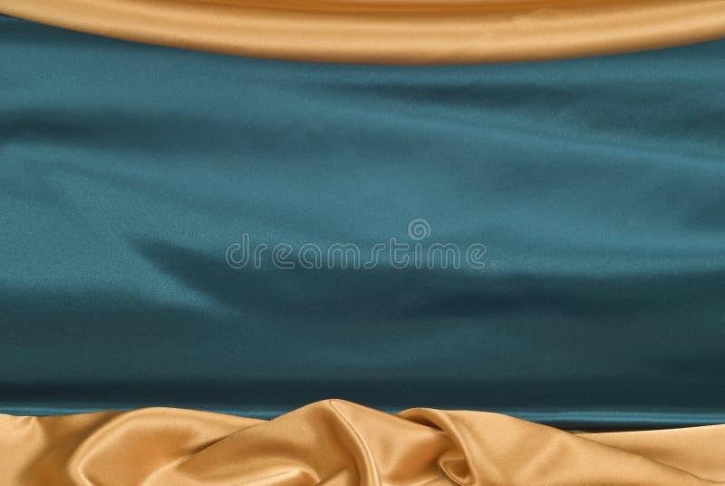 Fondo del blu reale del raso e dell'oro immagine stock libera da diritti
