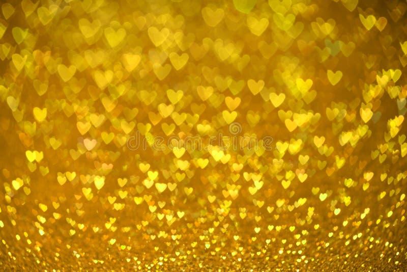 Fondo del bokeh del cuore dell'oro Struttura di giorno di biglietti di S. Valentino immagini stock libere da diritti