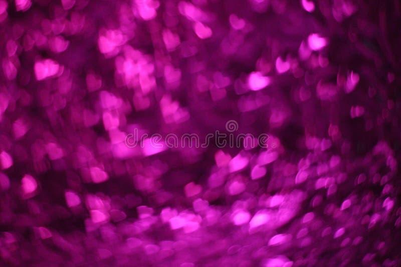 Fondo del bokeh de los corazones púrpuras, extracto púrpura del bokeh imagenes de archivo