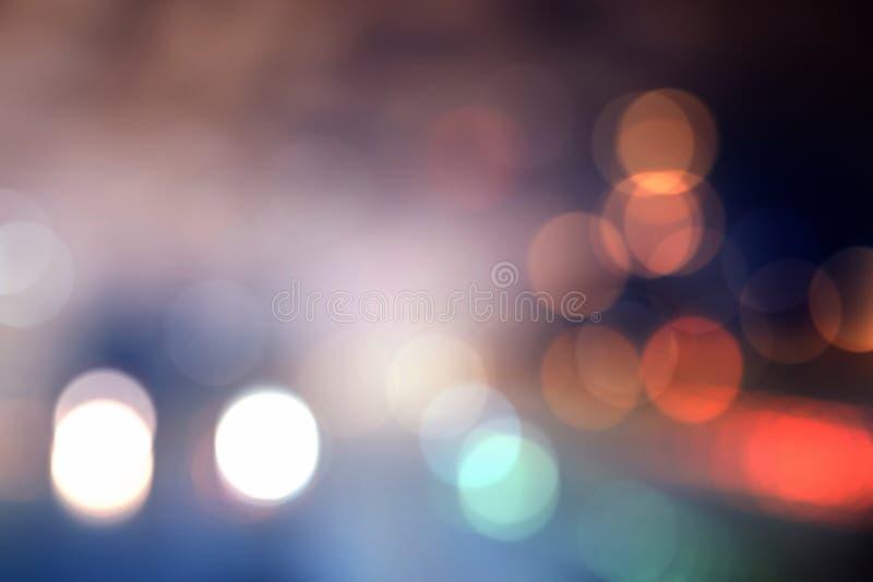Fondo del bokeh delle iluminazioni pubbliche della città di notte fotografia stock libera da diritti