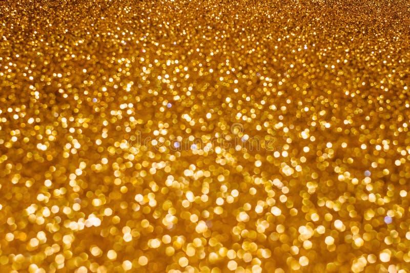 Fondo del bokeh del extracto del día de fiesta de la Navidad con las luces del oro Fondo del bokeh del brillo fotografía de archivo libre de regalías