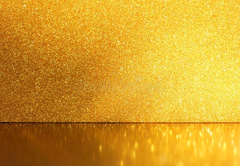Fondo del brillo del oro, foco selectivo, reflexiones de oro fotografía de archivo libre de regalías