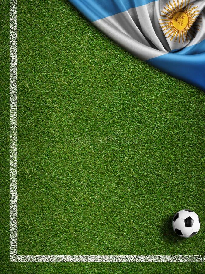 Fondo del campo de fútbol con la bola y la bandera de la Argentina imagenes de archivo