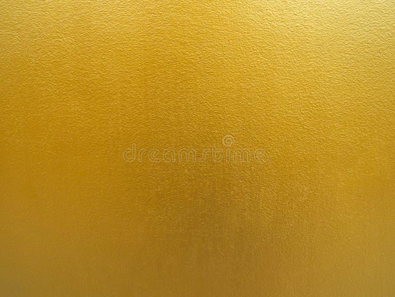 Fondo del color oro Diseño áspero de la textura del oro en la pared fotografía de archivo