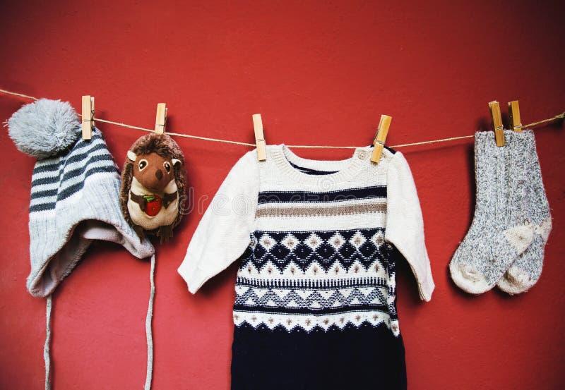 Fondo del concepto de la moda del otoño o del invierno del bebé imagen de archivo