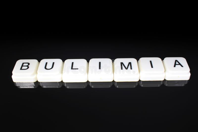 Fondo del contesto della copertura dell'etichetta di titolo di titolo di parola del testo di bulimia Blocchetti del giocattolo de immagine stock libera da diritti