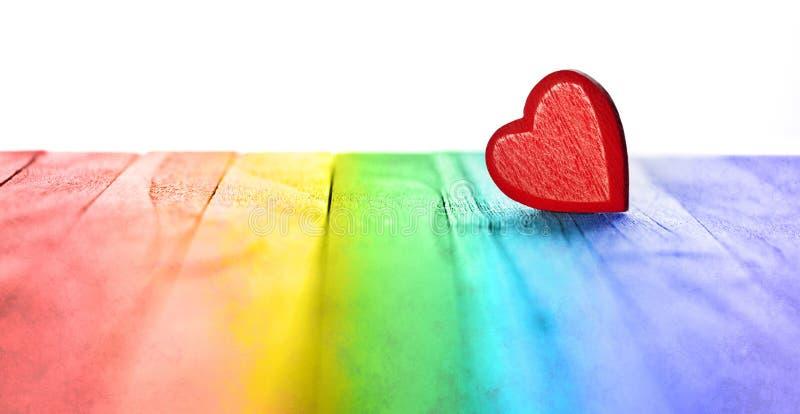 Fondo del cuore di amore dell'arcobaleno dell'insegna immagini stock