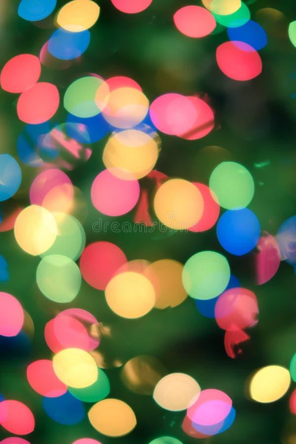 Fondo del día de fiesta con las luces borrosas fotos de archivo