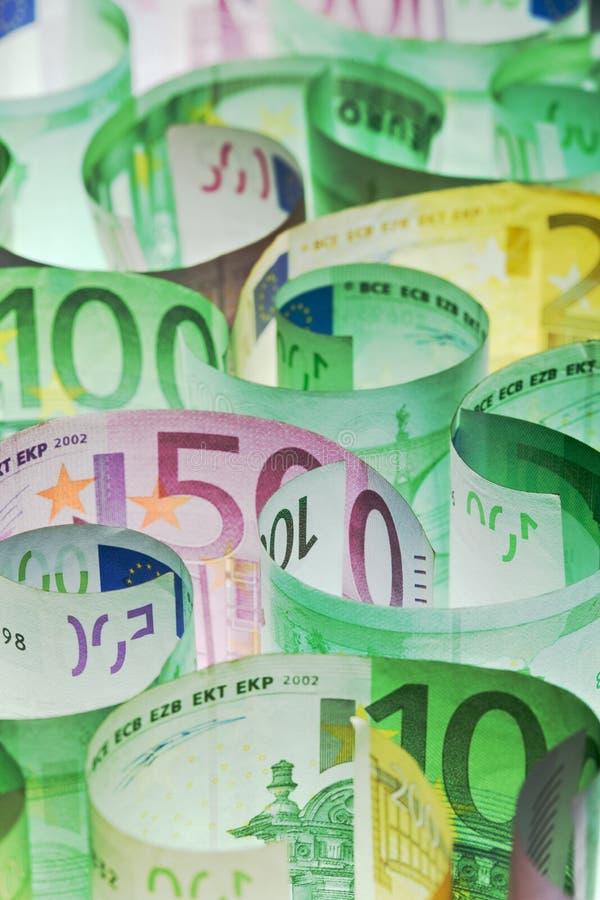 Fondo del dinero - billetes de banco euro bajo encendido foto de archivo libre de regalías