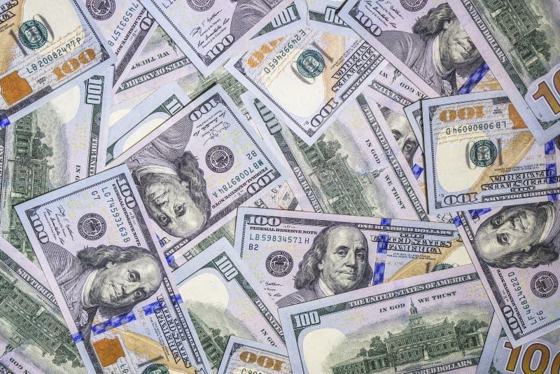 Fondo del dinero del nuevo ciento efectivo de los billetes de dólar imagen de archivo