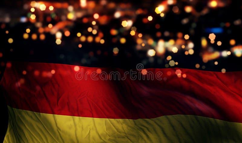 Fondo del extracto de Bokeh de la noche de la luz de la bandera nacional de Alemania imagen de archivo libre de regalías