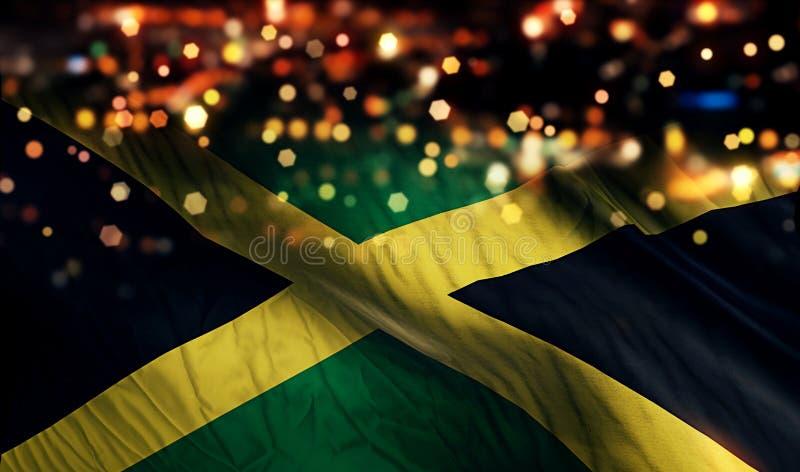 Fondo del extracto de Bokeh de la noche de la luz de la bandera nacional de Jamaica foto de archivo libre de regalías