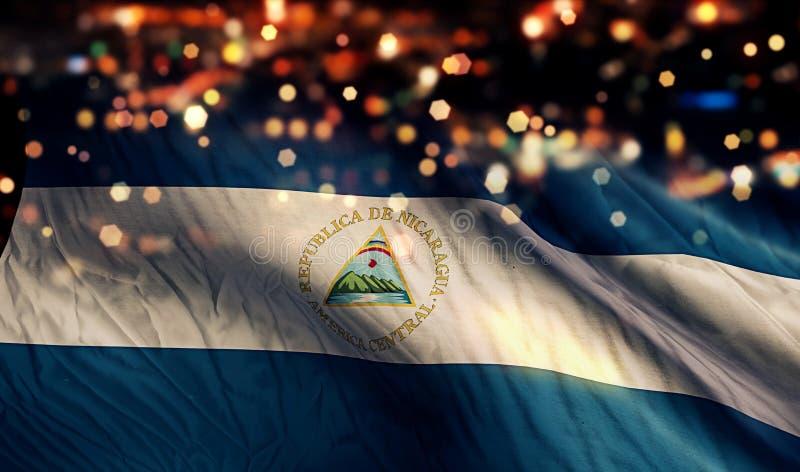 Fondo del extracto de Bokeh de la noche de la luz de la bandera nacional de Nicaragua fotos de archivo
