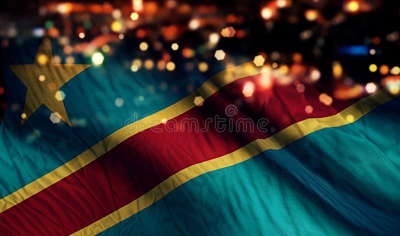 Fondo del extracto de Bokeh de la noche de la luz de la bandera nacional de República Democrática del Congo fotos de archivo