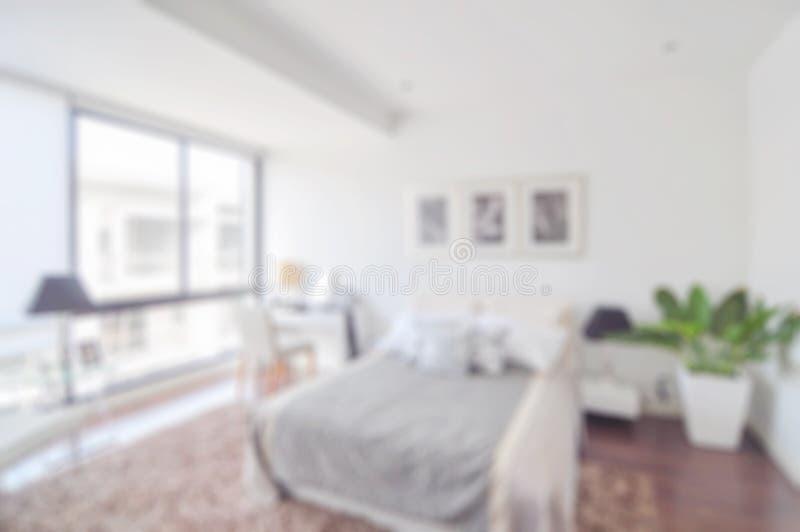 Fondo del extracto de la falta de definición de Defocus del dormitorio moderno fotografía de archivo