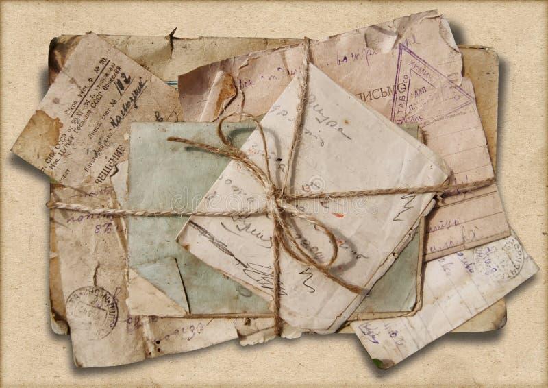 Fondo del Grunge con la pila de viejas letras fotografía de archivo libre de regalías