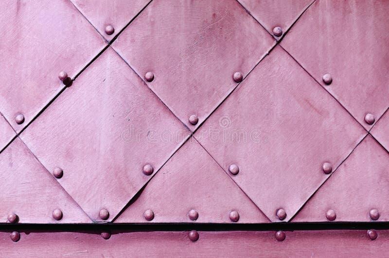 Fondo del grunge del metal en colores rosas claros foto de archivo