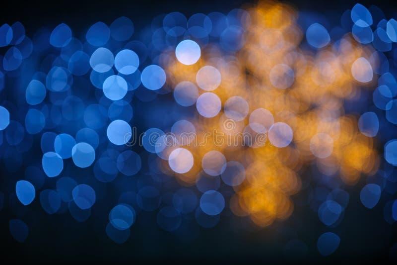 Fondo del invierno con las luces y el copo de nieve del bokeh fotografía de archivo