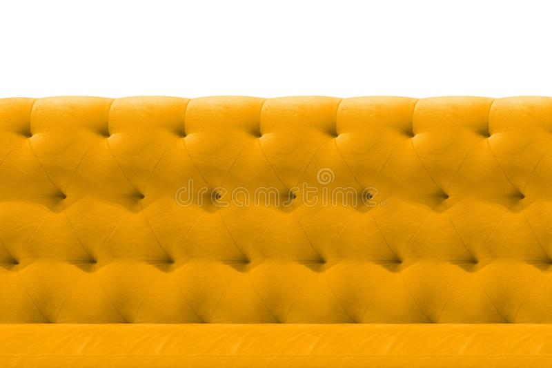 Fondo del modelo del primer del amortiguador del terciopelo del sofá de lujo del amarillo o del oro en blanco foto de archivo