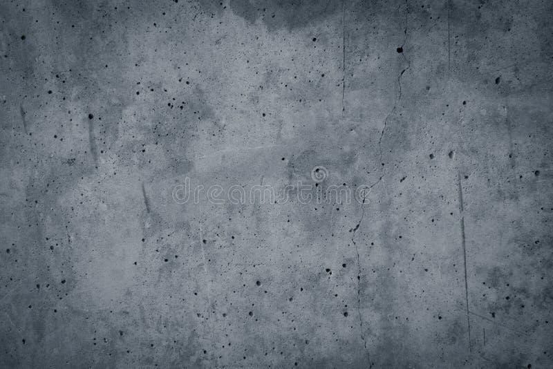 Fondo del muro di cemento del gesso dipinto grey d'annata. Bordo scuro fotografie stock