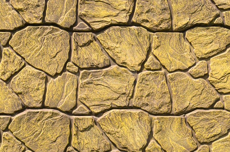 Fondo del muro di mattoni platted del vecchio oro fotografia stock