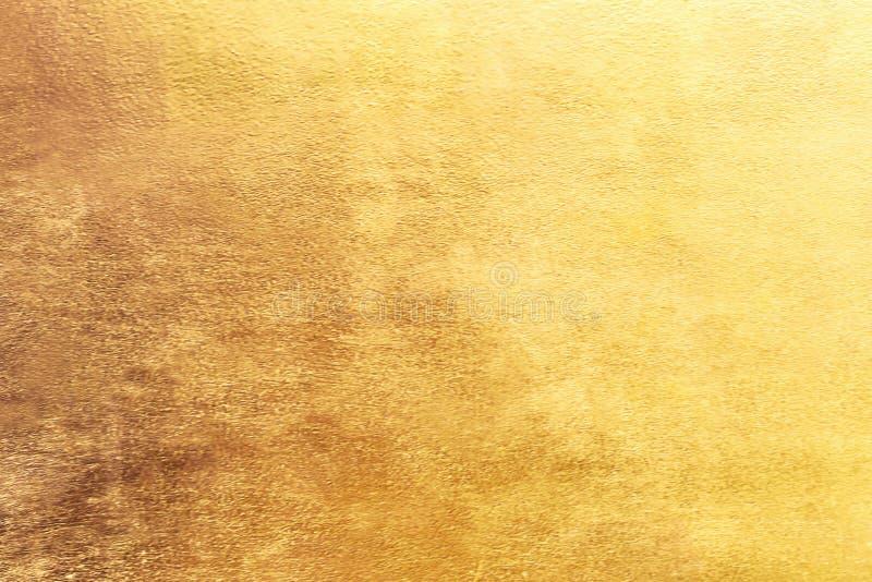 Fondo del oro o texturas y sombras, paredes viejas y rasguños fotografía de archivo