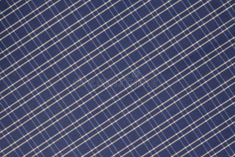 Fondo del paño azul y blanco de la tela escocesa fotos de archivo libres de regalías