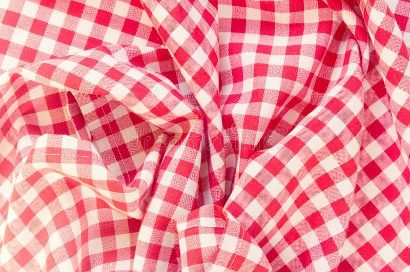Fondo del panno di picnic sgualcito rosso fotografia stock