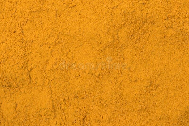 Fondo del polvo de la cúrcuma Textura de aderezo natural Ingredientes naturales del especia y alimentarios fotos de archivo