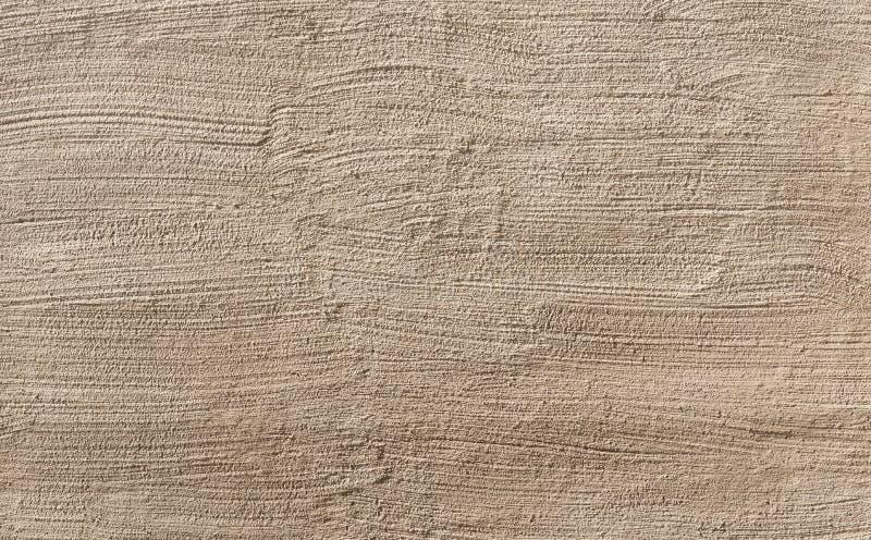 Fondo del primo piano beige di struttura dello stucco della parete fotografia stock libera da diritti