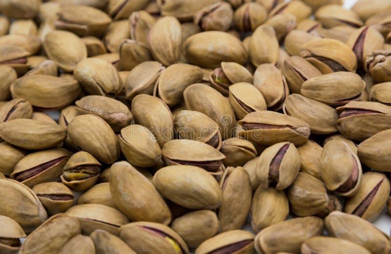 Fondo del primo piano dei pistacchi I dadi immagini stock