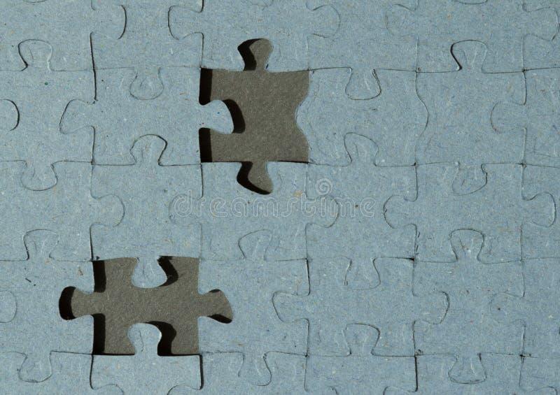 Fondo del puzzle con due posti vuoti immagine stock libera da diritti