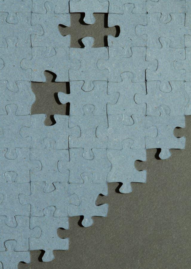 Fondo del puzzle con due posti vuoti immagini stock
