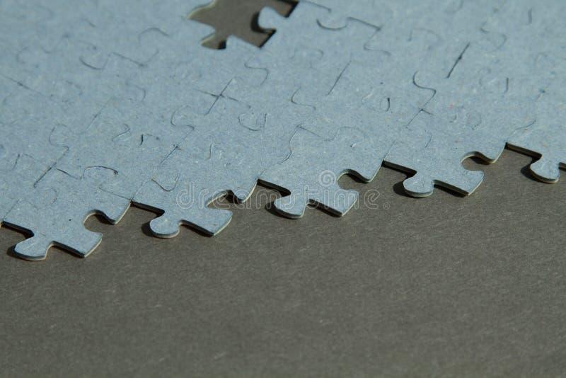 Fondo del puzzle con i posti vuoti uno fotografia stock