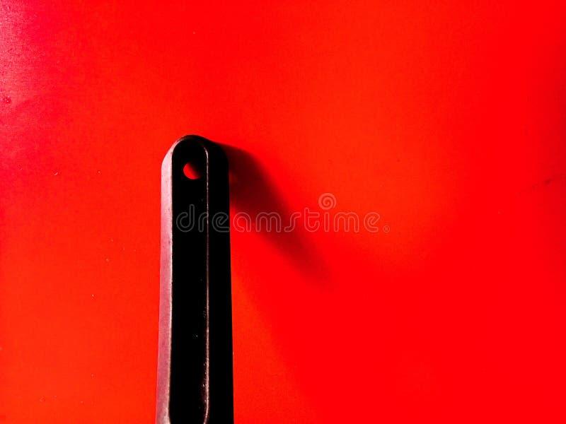 fondo del rojo de la abstracción de la manija de la cacerola foto de archivo libre de regalías