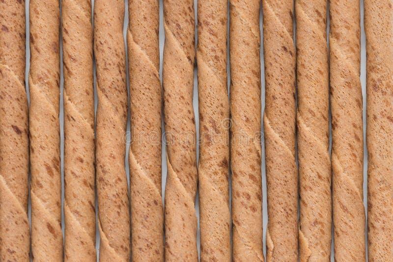 Fondo del rollo de los palillos de la oblea del chocolate imagenes de archivo