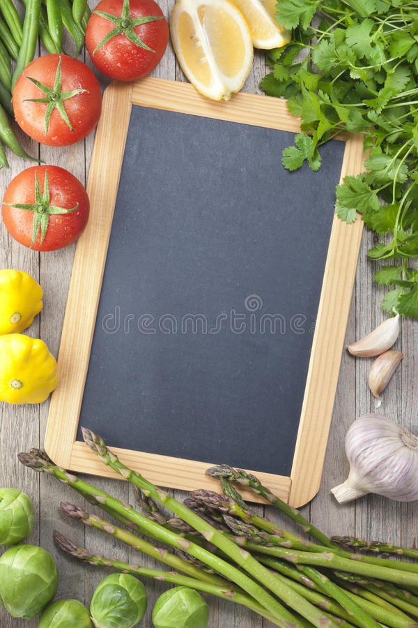 Fondo del segno delle verdure della lavagna fotografie stock