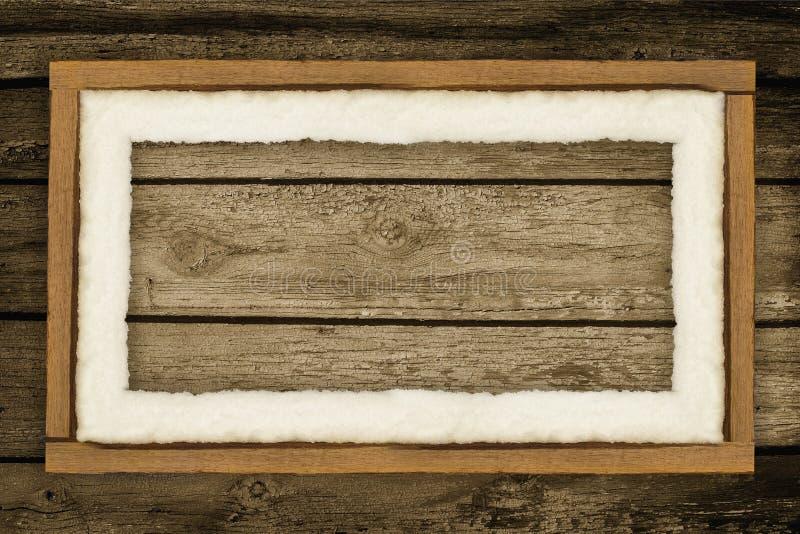 Fondo del tablero de madera con nieve foto de archivo