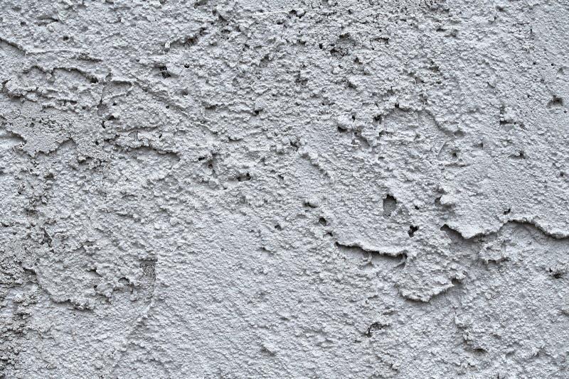 Fondo del yeso de la fachada Fondo decorativo del yeso monolítico sencillo Papel pintado raspado de una sola capa del yeso del ce imagen de archivo libre de regalías