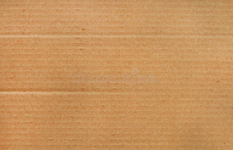 Fondo dell'estratto dello strato del cartone, struttura della scatola di carta marrone fotografia stock
