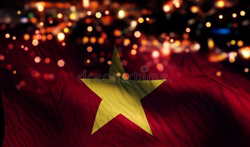 Fondo dell'estratto di Bokeh di notte della luce della bandiera nazionale del Vietnam immagini stock