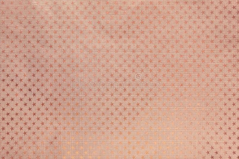 Fondo dell'oro di Rosa dalla carta del foglio metallizzato con un modello di stelle immagini stock