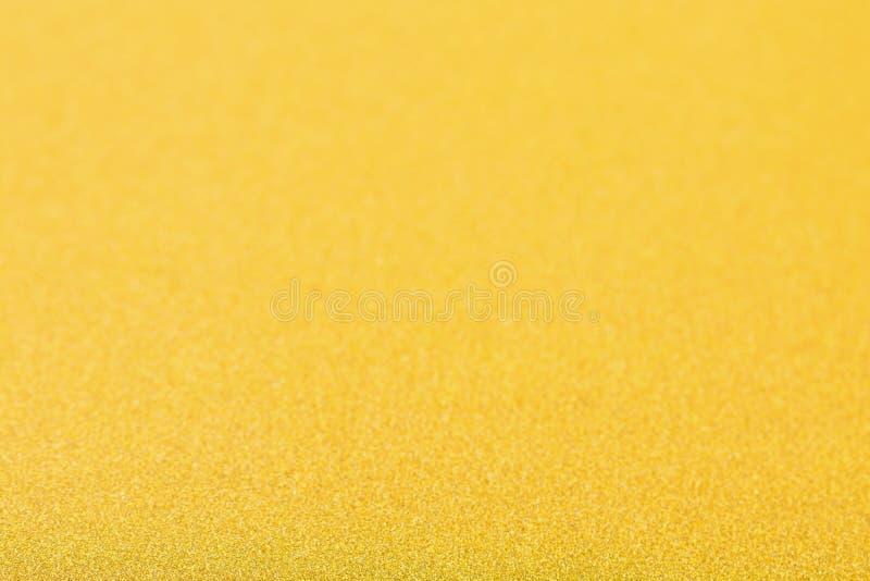 Fondo dell'oro, spazio in bianco astratto del bokeh di scintillio di Natale per il desi immagine stock libera da diritti